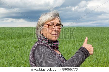 Senior Woman In The Wind With Thumbs Up