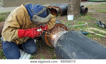 Welder With Leather Welding Protective Clothing
