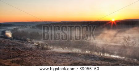 Sunrise Through A River Mist In The Early Spring