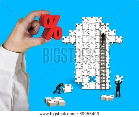 Hand Hold Percentage Sign With Businessmen Building Arrow Jigsaw Puzzle