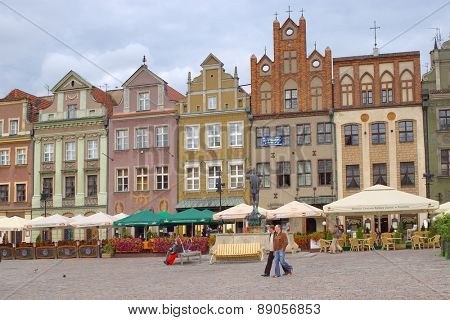 POZNAN, POLAND - AUGUST 29, 2006: People on the market square in old city. Poznan is among the oldest cities in Poland and was one of the most important centers in the early Polish state