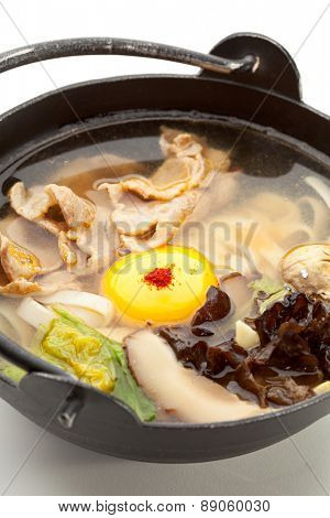 Pork Soup with Mushrooms, Chinese Cabbage, Noodles, Red Pepper and Egg Yolk