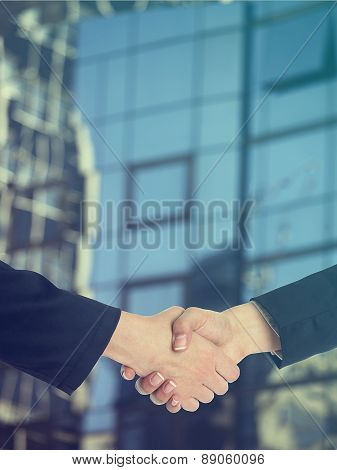 Architectural Handshaking In Front Of Building