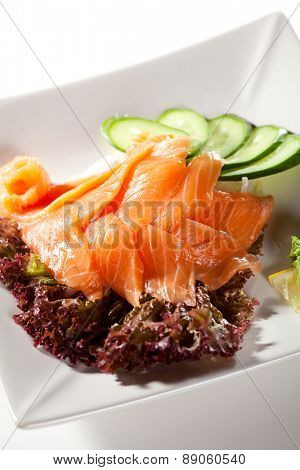 Salmon Sashimi - Sliced Raw Salmon on Daikon with Seaweed and Cucumber