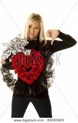 Woman Holding Heart Wreath Thumbs Down