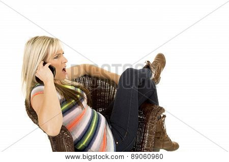 Woman In Colorful Shirt Sit And Shocked On Phone