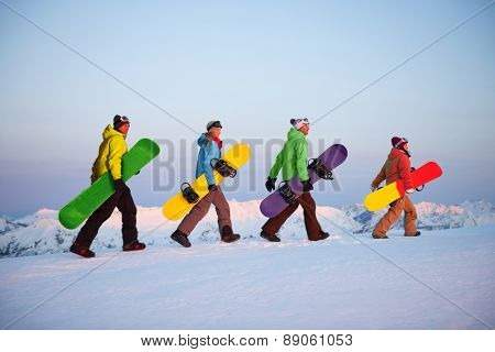 Group of snowboarders on top of the mountain Concept