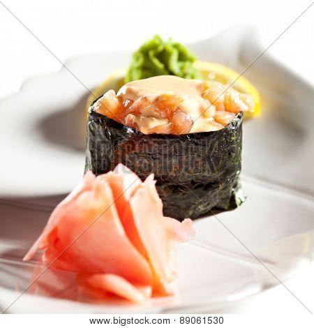 Spicy Salmon Gunkan Sushi. Garnished with Ginger and Wasabi