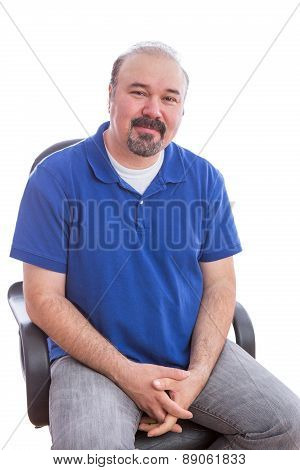 Optimistic Man On A Chair Looking At The Camera
