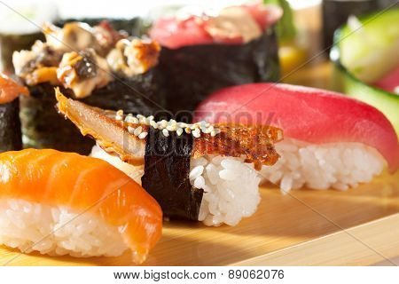 Japanese Cuisine - Sushi Set: Salmon, Conger and Tuna Sushi with Salad Leaf. Nigiri, Maki Sushi and Sashimi