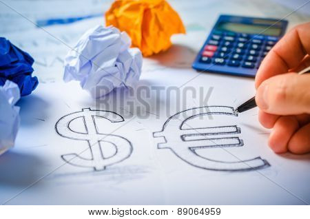 Hand Drawing A Dollar Sign And Euro Sign