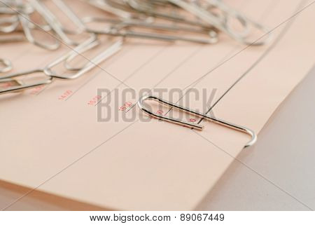 Paper Clip And Paper Isolated