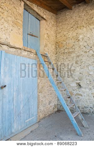 Old French bard with blue doors and stairs