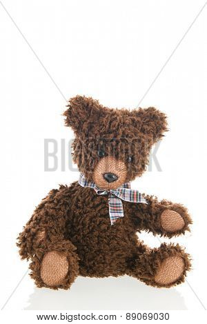 Stuffed handmade brown bear isolated over white background
