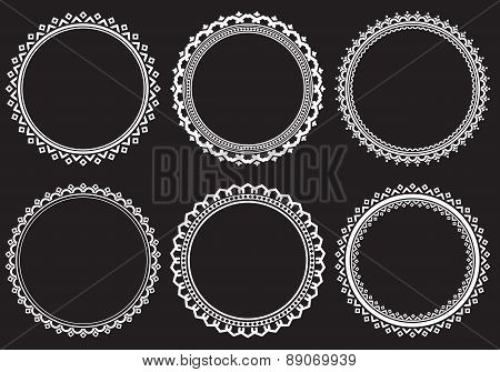 Set of 6 round openwork frames on a dark background. Vector illustration.