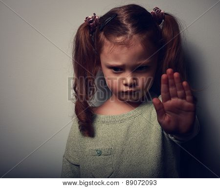 Kid Girl Showing Hand Signaling To Stop Violence And Looking Down. Closeup