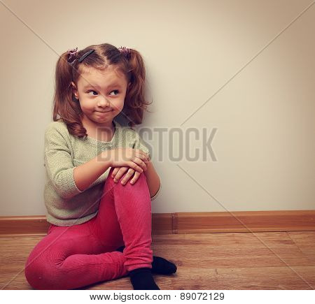 Thinking Humor Girl Sitting On The Floor In Fashion Clothes. Vintage Portrait