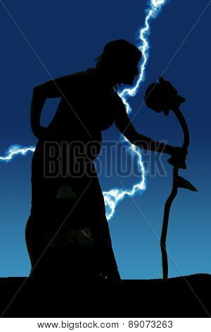 Silhouette Of A Woman Pregnant Smell Flower