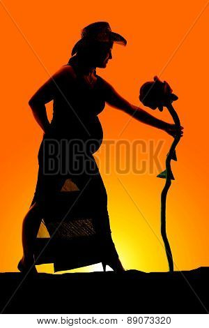 Silhouette Of A Woman Pregnant With Hat And Big Flowers