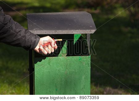Male Hand Breaks A Pack Of Cigarettes