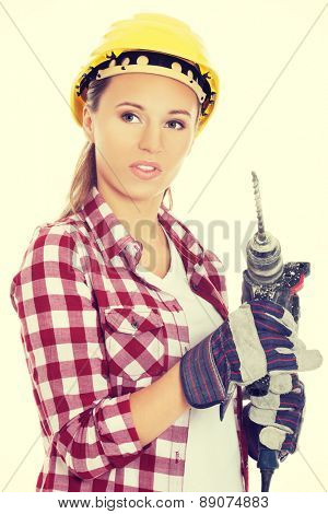 Portrait of woman holding drill