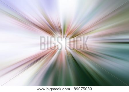 Rainbow light glow rays represented by a star burst glowing blue green red and purple hues radiating