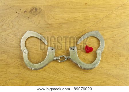 Heart bound by love, police handcuffs and heart