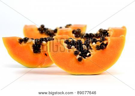 Papaya on white background - close-up