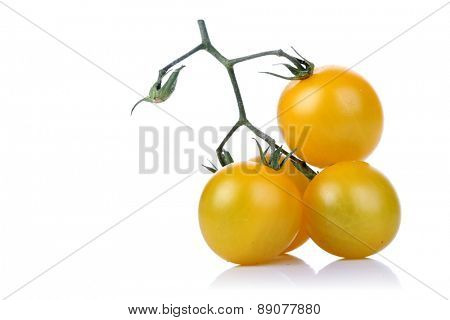Bunch of yellow tomatoes on white backgrond