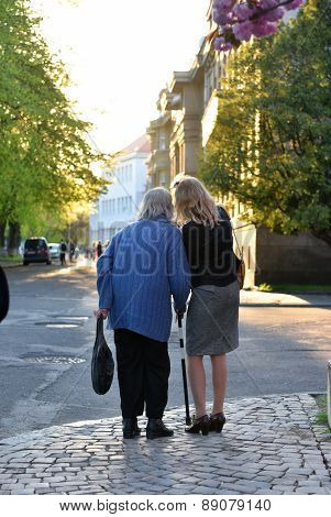 Old Woman And Her Daughter In The Park