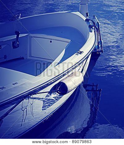Wooden Boat In Blue