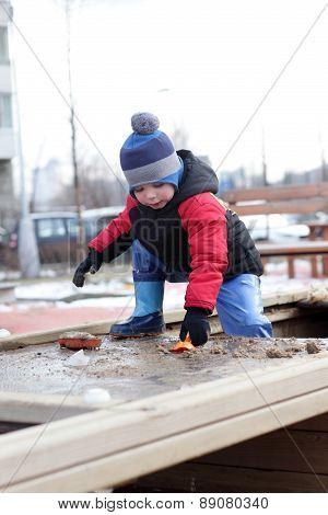 Kid Playing In The Sandbox