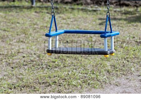 Children's Swing On Chains At A Playground