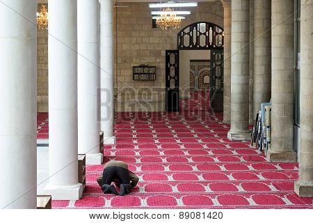 A Man Praying In The Al Husseini Mosque in Amman, Jordan