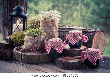 Wedding Still Life With Decoration In Rustic Style And Jars Of Fruit Jam. Retro Stylized Photo.