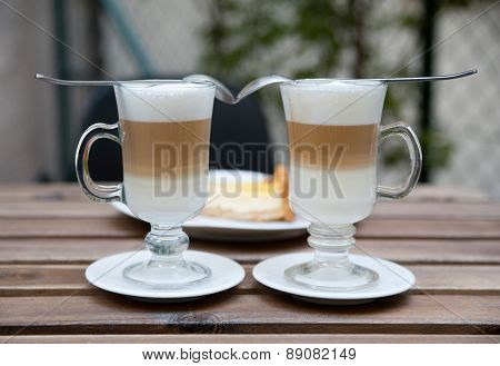 Close-up of two cups of coffee latte