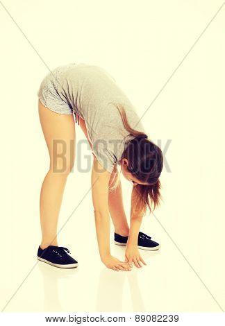 Young beautiful caucasian woman stretching