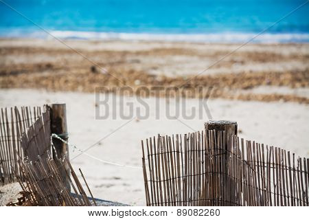 Wooden Palisades By The Beach
