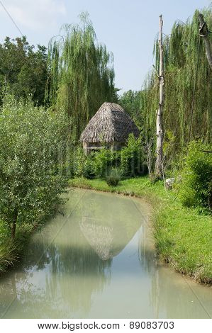 Thatched Hut On The River Bank