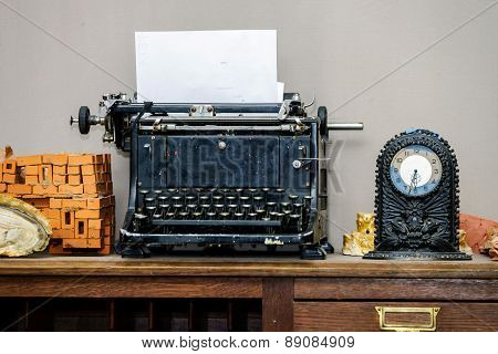 Old Vintage Typewriter With Blank Paper Sheet