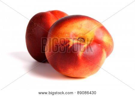 Studio shot of nectarine on whte background