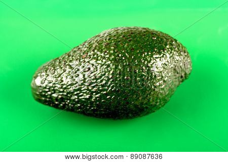 Studio shot of Avocados on green background