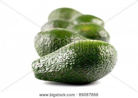 Closeup of avocados on white background