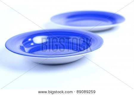 Two empty plates on white background