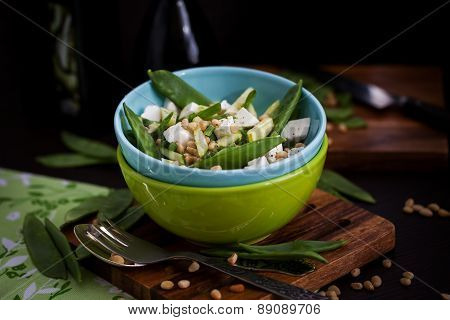 Fresh Delicious Cucumber, Green Peas, Feta And Pine Nuts Salad