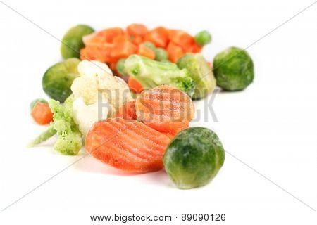 Frozen vegetables on white background