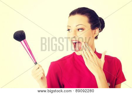 Happy visage artist holding brushes