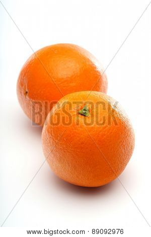 Oranges on white background - close-up