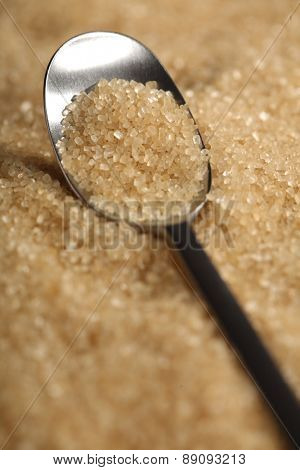 Brown sugar and spoon - close-up