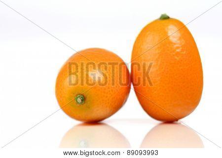 Close-up of kumquats on white background